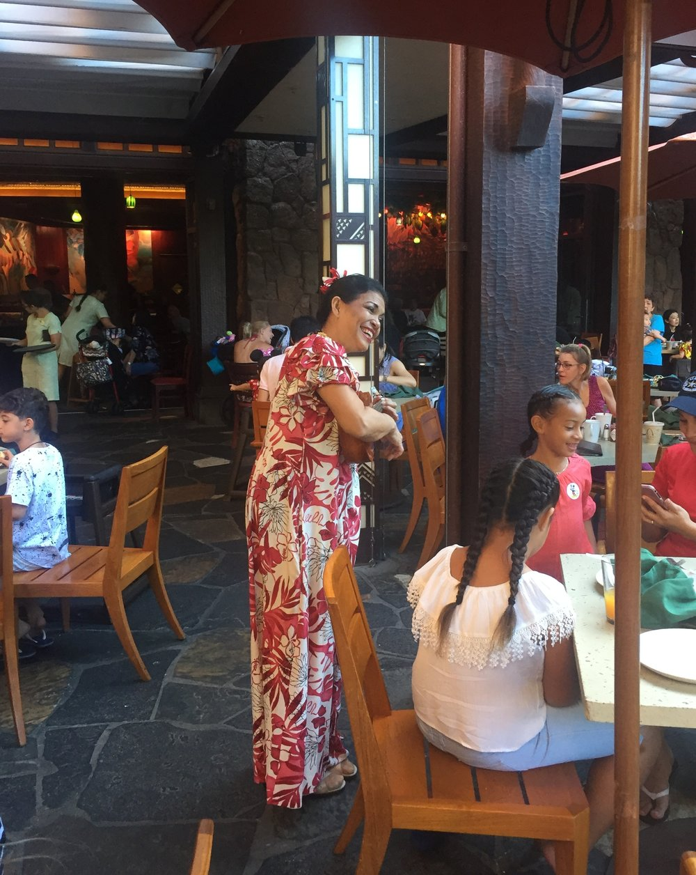 Aunty performing throughout the restaurant.