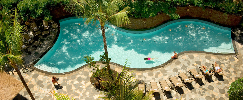 The relaxing Wailana pool. You can see how close the bar is in the lower left corner. (Photo credit: disneyaulani.com)