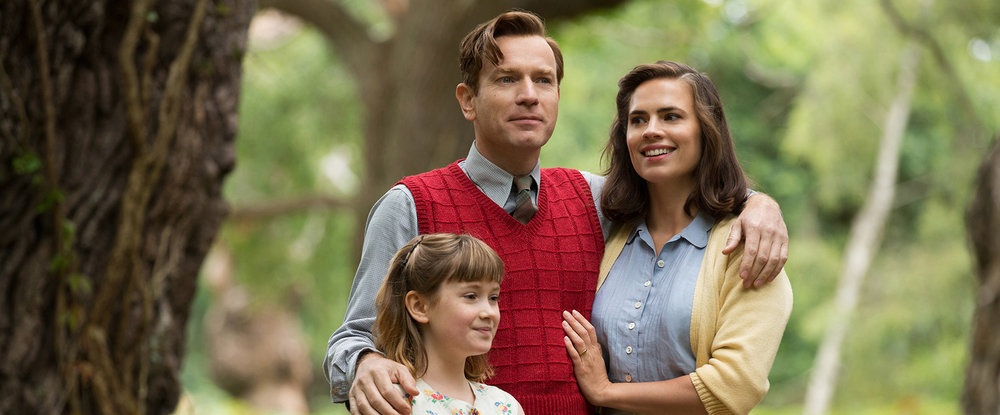 Christopher Robin (McGregor) is living the grown up life with wife Evelyn (Atwell) and daughter Madeline (Carmichael).