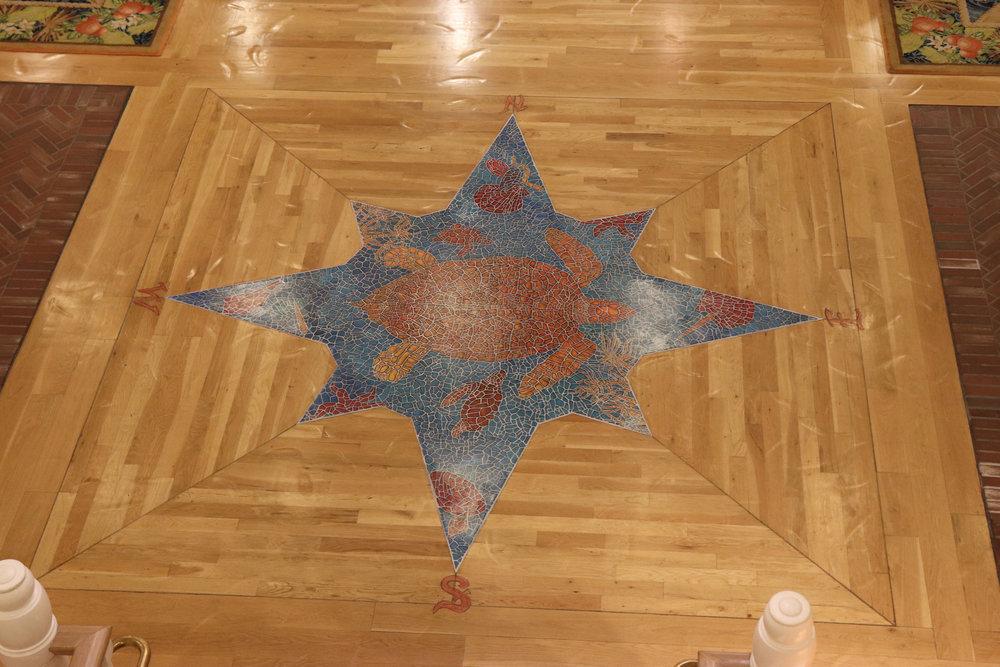 A turtle mosaic on the lobby floor.