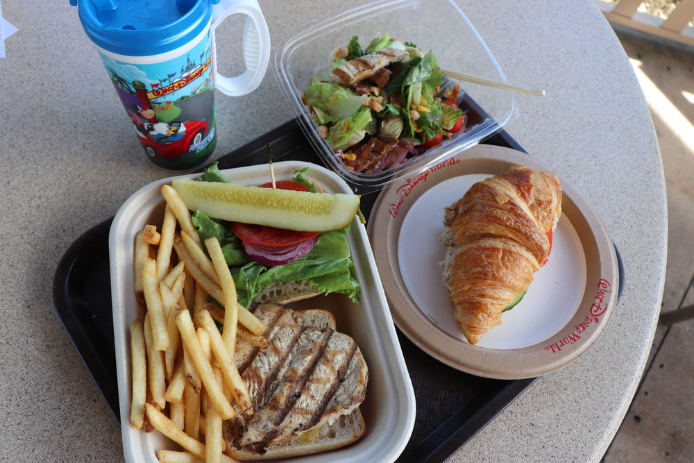 Chicken sandwich with friends, tuna croissant sandwich and half of the create your own salad.