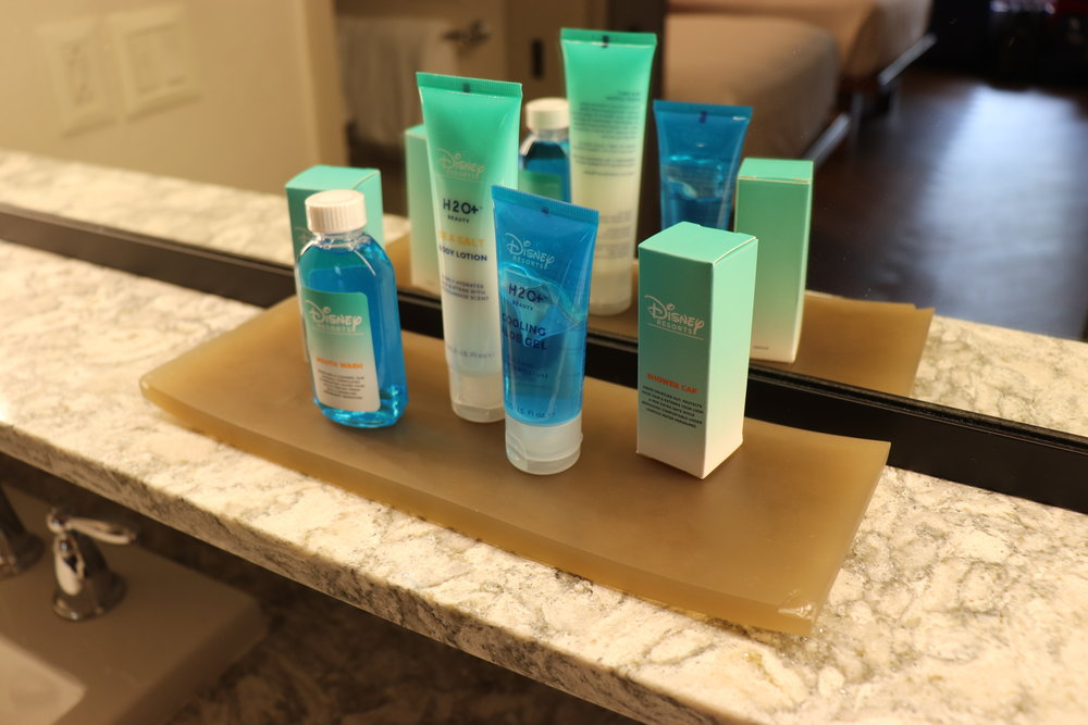 Travel sized toiletries above the sink.