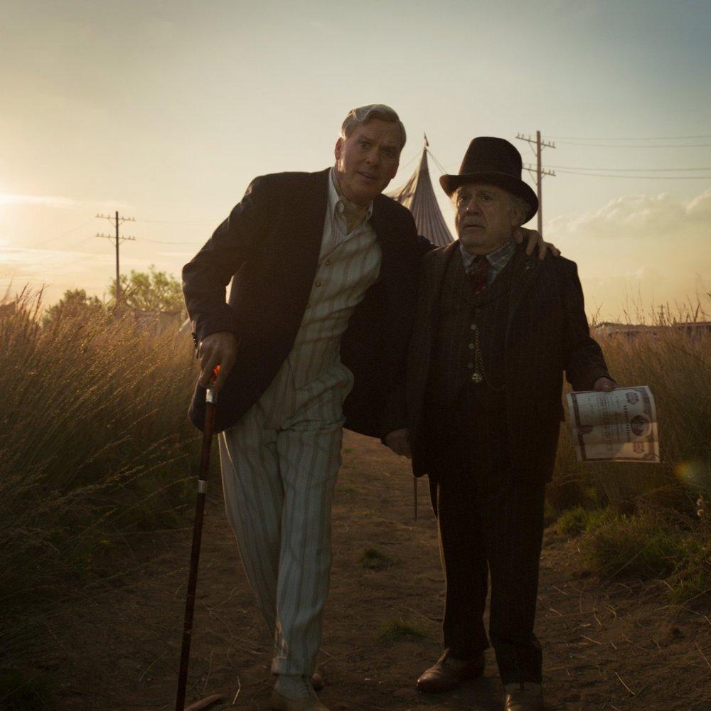 Vandevere (Keaton) and Medici (Devito) discussing the future.