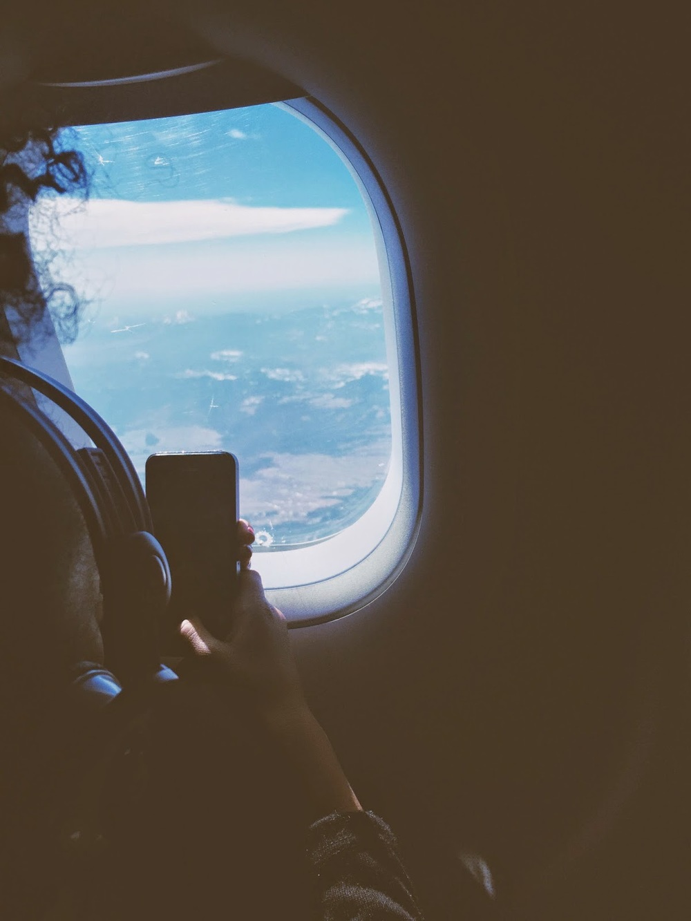 char taking a pic of the plane passing over colorado.
