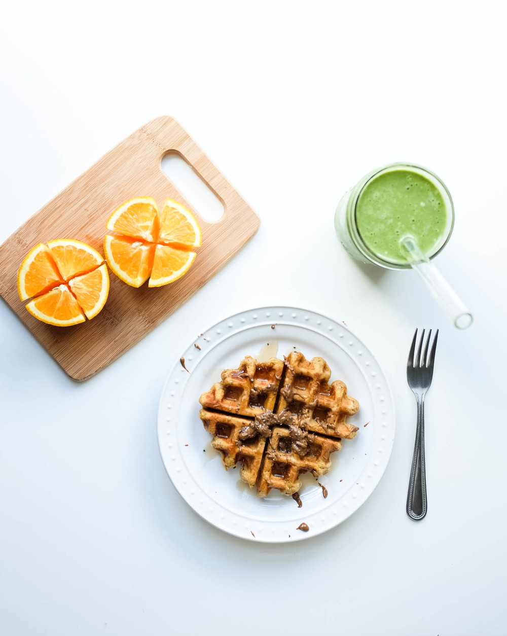 vegan sweet potato waffles drizzled with almond maca butter + maple agave syrup