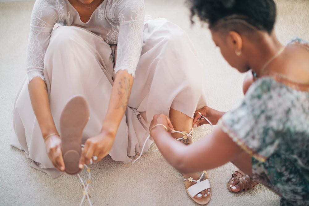 My sister-friend, Racheal, helping me lace my sandals. Heels were not an option for me! Comfort over everything.