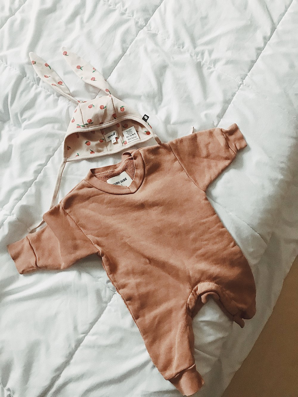 Baby things are way too cute. Always.  Jumpsuit  can be found here, hat  here.