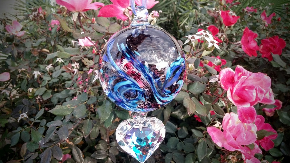 Memorial Glass Art containing a small amounts of cremains from a loved family pet dog.