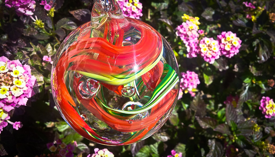 Glass Memorial Ornament holding cremated ashes of pet dog or cat. Great way to remember loved ones.