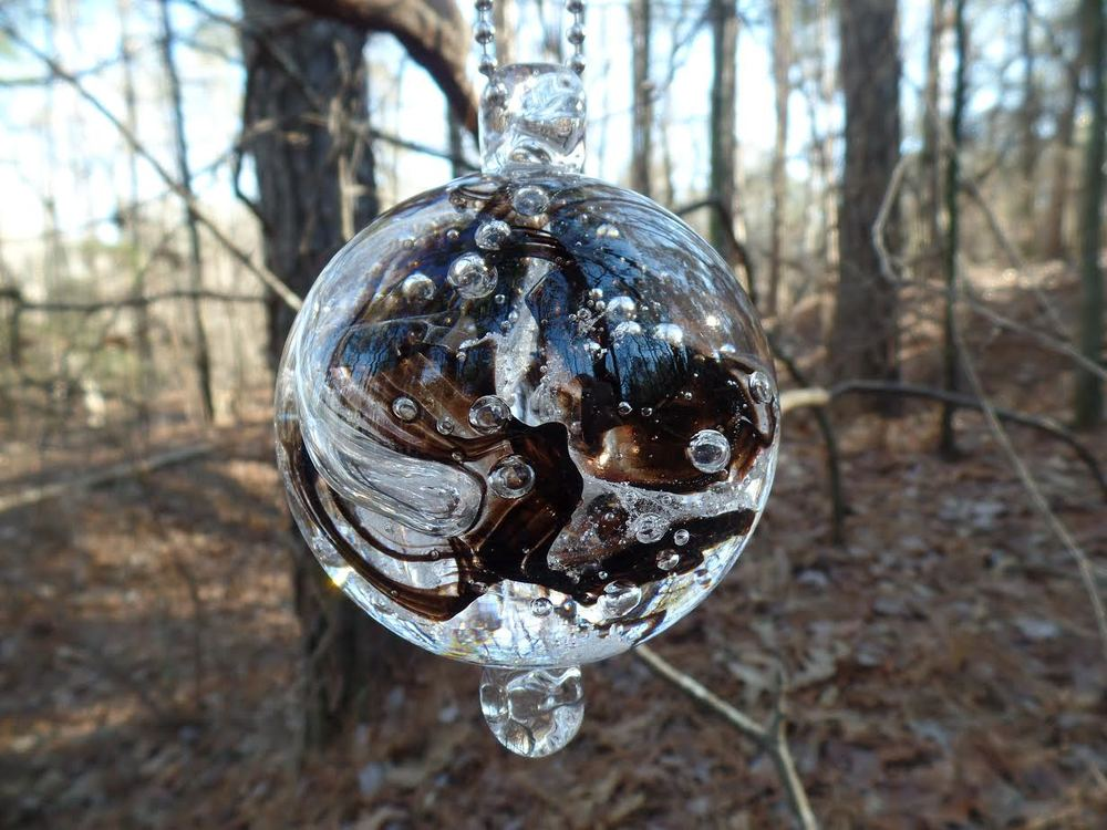 Glass Sphere with Cremated Ash of Abandoned Dog