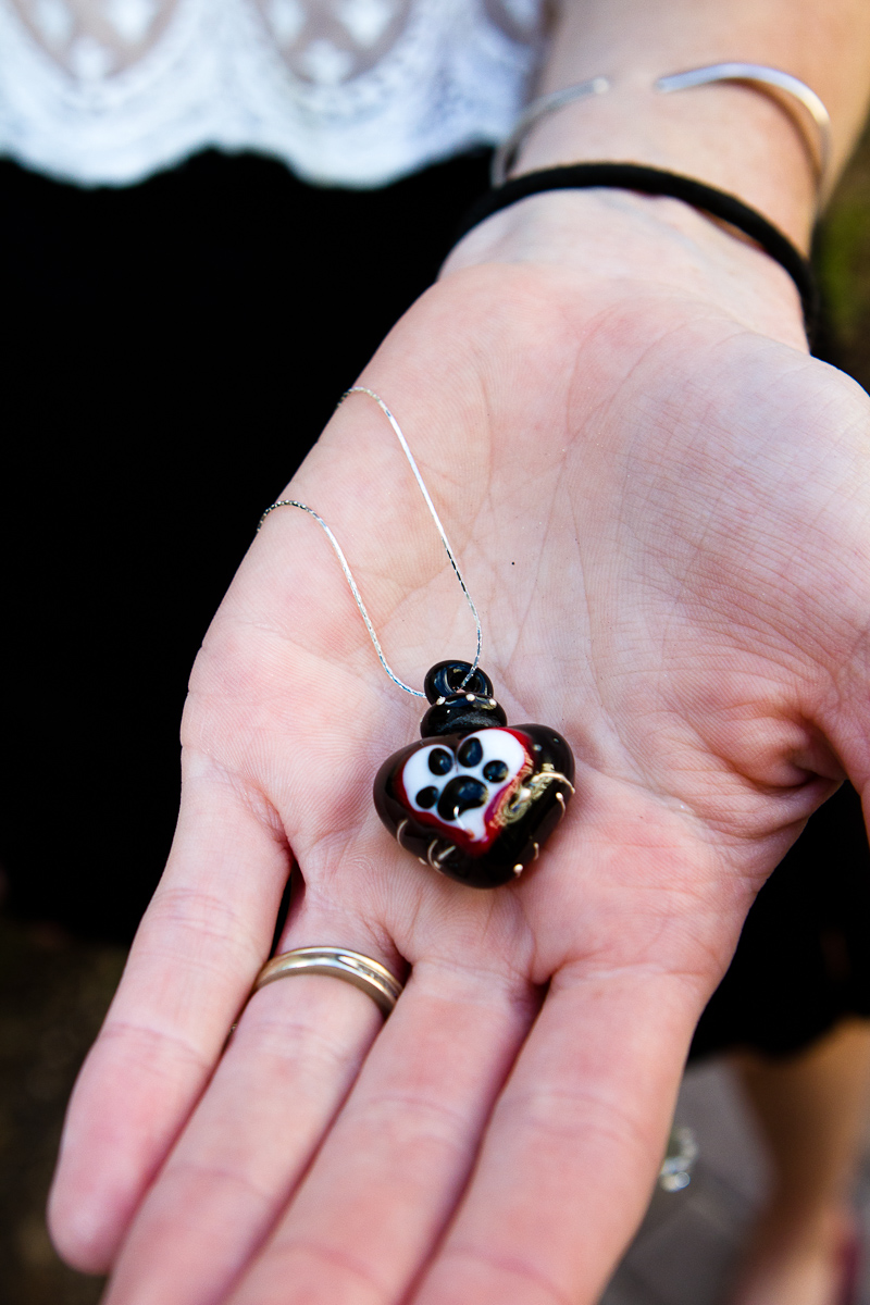 Memorial Glass Pendant holds a small amount of cremation ash and hair.