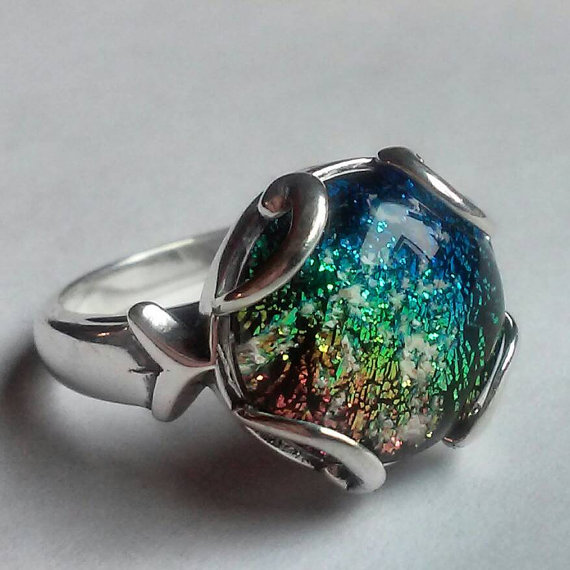 Glass ring with cremation ash from person and pets