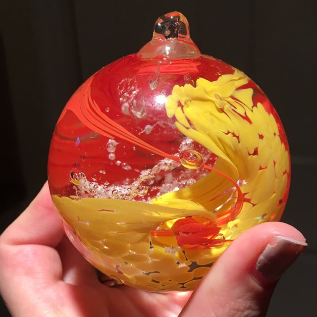 Red and Yellow Glimmer Memorial Glass Orb with Ash
