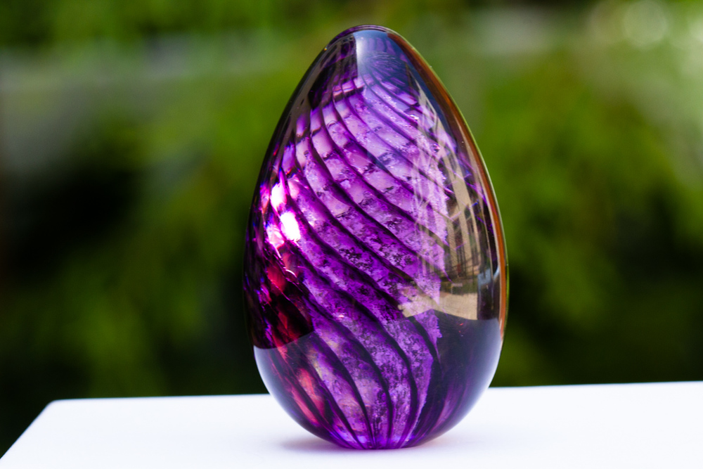 Lilac Spiral Glass Egg containing cremation ash from person or pet