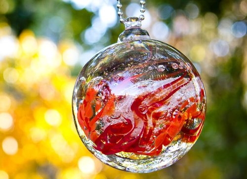 Garden Orbs Glass Cremation Urns Paperweights and Memorial Jewelry