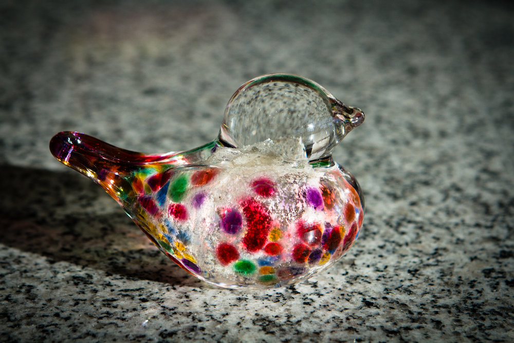 glass bird with cremation ash