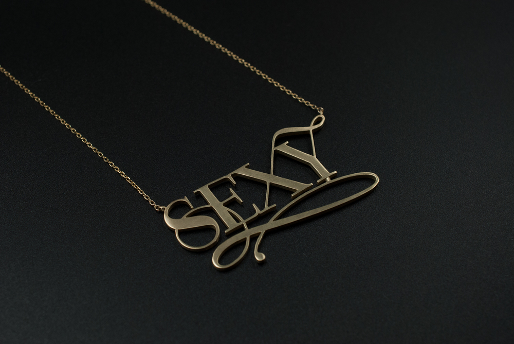 sexy gold typography necklace by moshik nadav new york