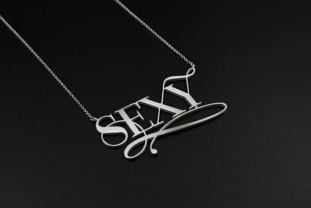 sexy silver typography necklace by moshik nadav new york