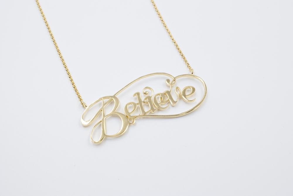 believe gold typography jewelry by moshik nadav nyc