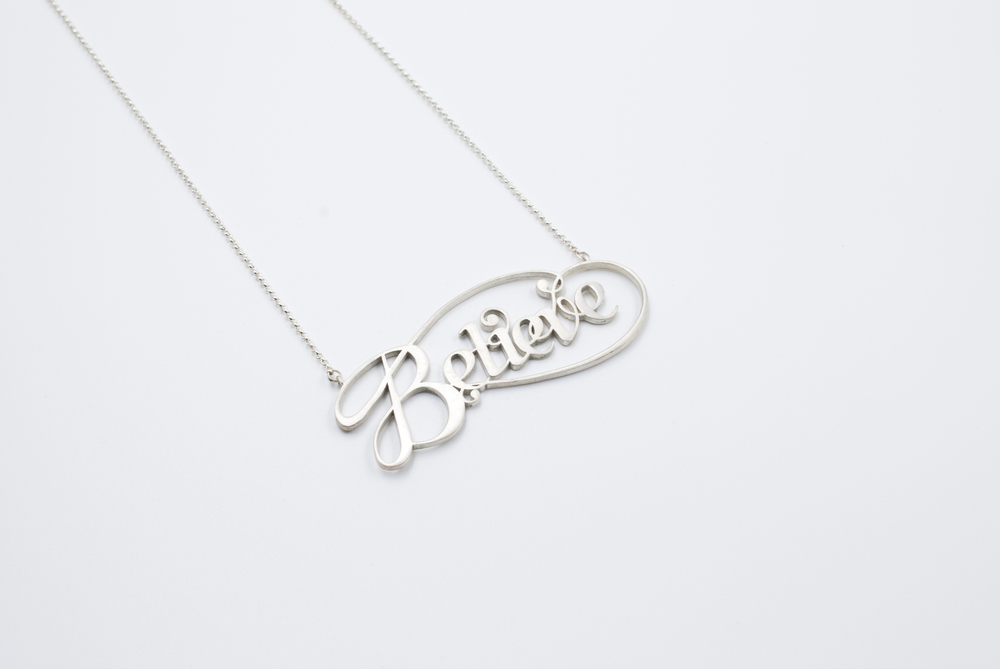 believe silver typography jewelry by moshik nadav nyc