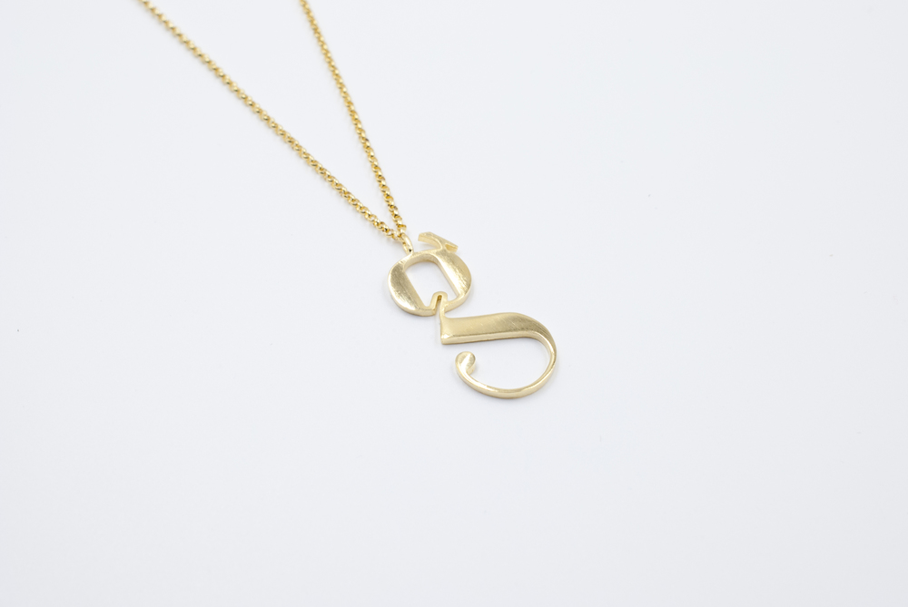 lowercase g gold necklace by moshik nadav typography nyc