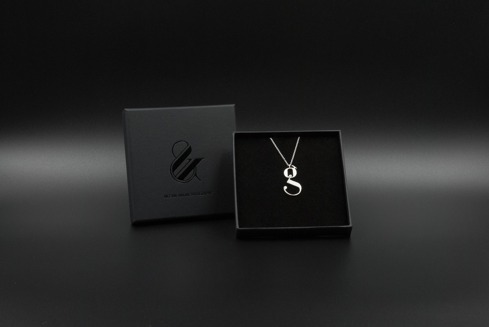 lowercase g silver necklace by moshik nadav typography nyc