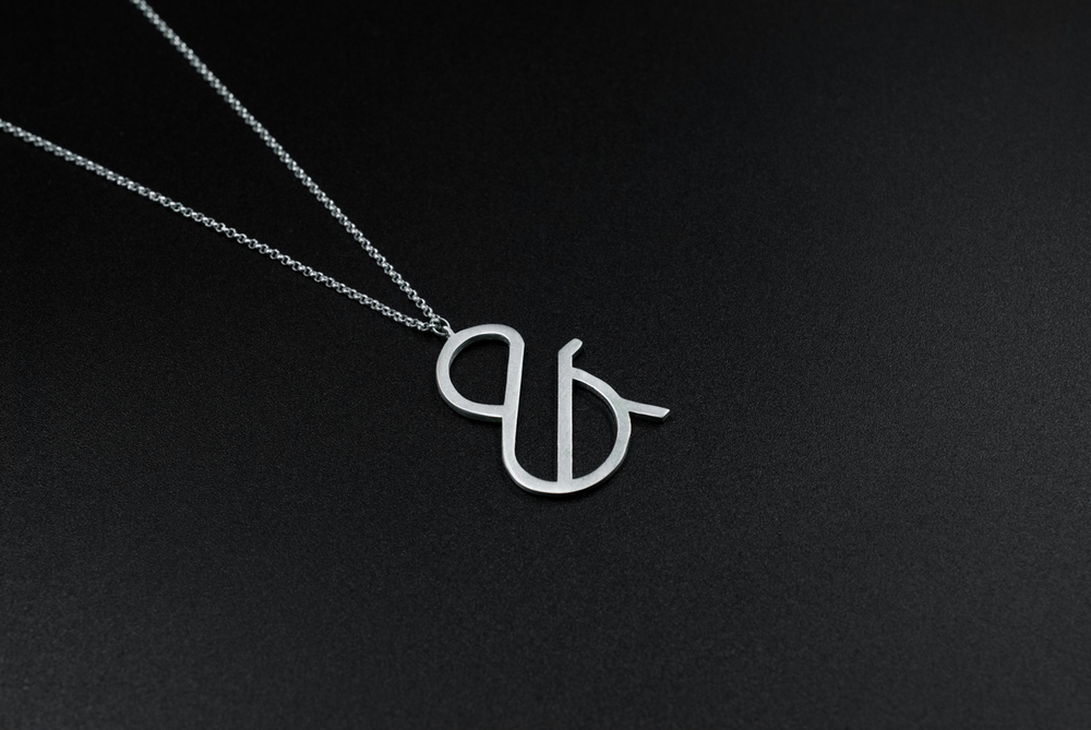 Silver ampersand necklace by moshik nadav typography nyc
