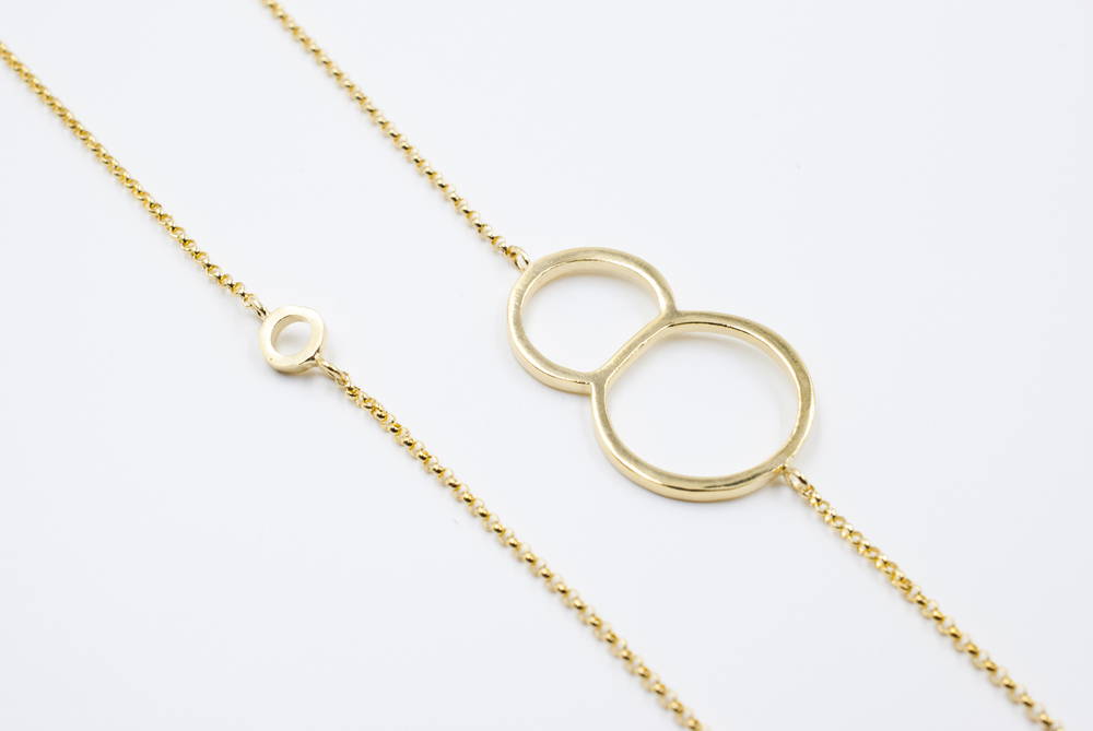 eight with circle typography gold necklace moshik nadav nyc