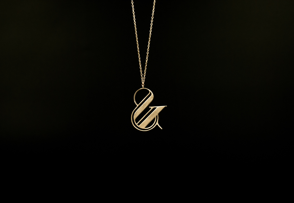 paris pro gold ampersand necklace moshik nadav typography