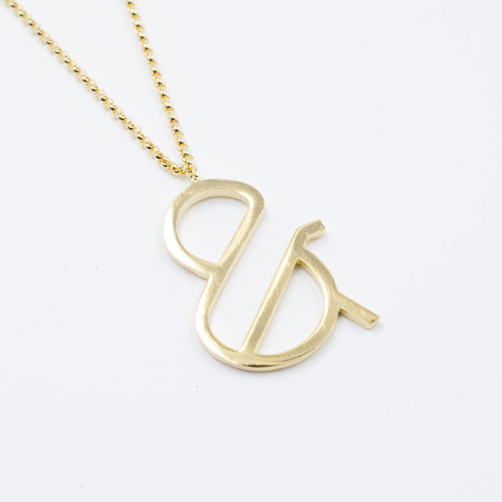 Unique Ampersand necklace. Design by Moshik Nadav Typography. Buy Now
