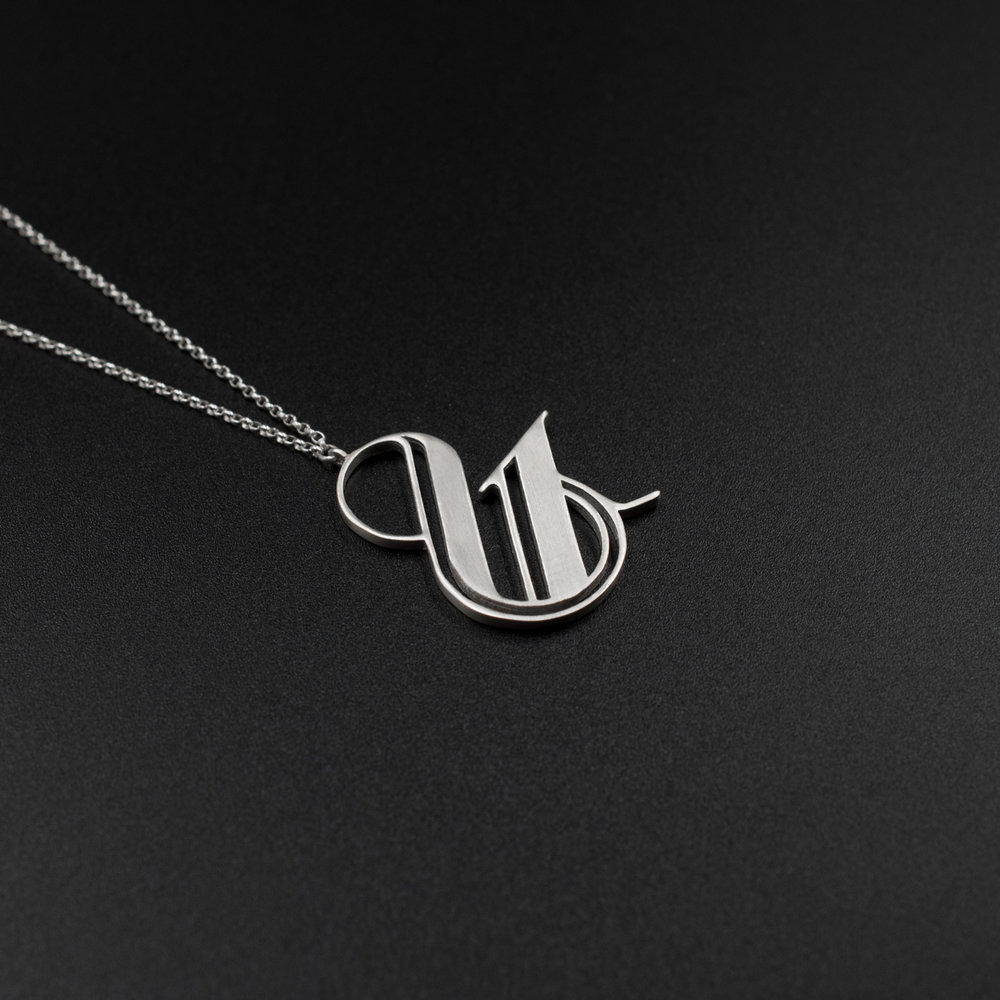 Ampersand logo silver necklace. Designed by Moshik Nadav Typography. Buy here