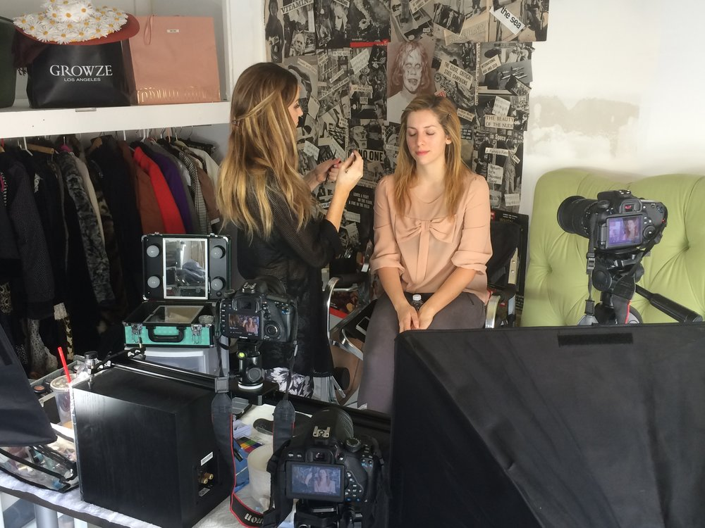Kelly filming a segment for the youtube channel Strawburry17