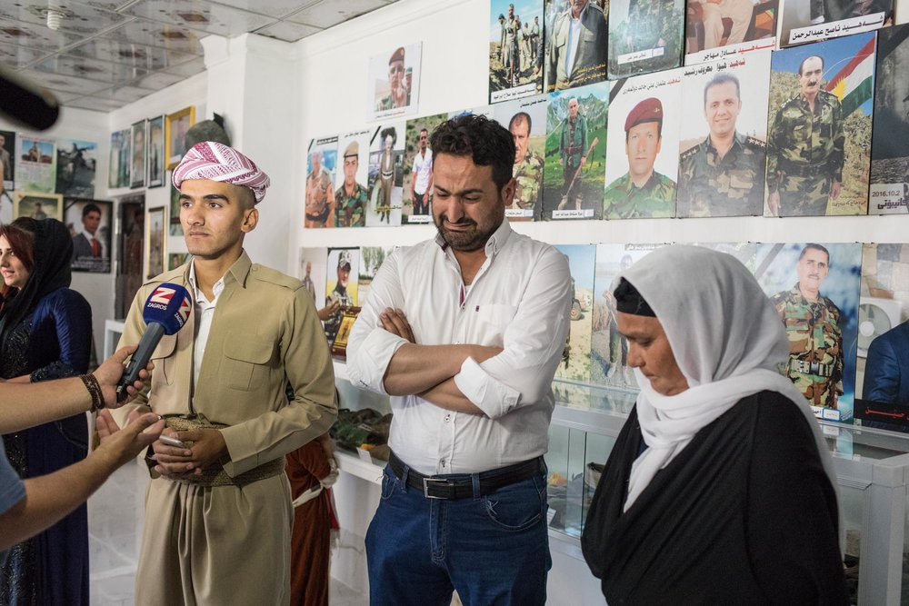 Family grieves the loss of a family member at a Peshmerga memorial opening in Soran, Iraq (May 2017).
