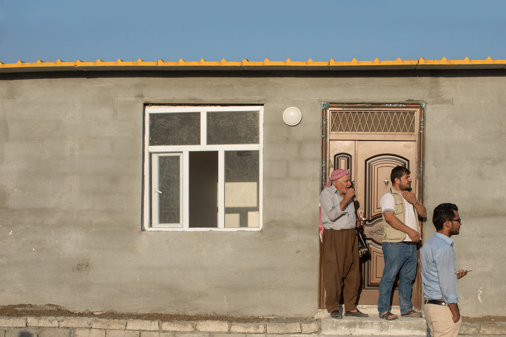Three Syrian Kurdish men inspect their new home in Azadi, Iraqi Kurdistan (September 2017).