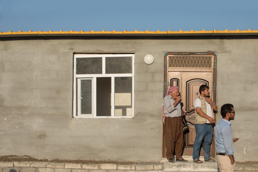 Three Syrian Kurdish men inspect their new home in Azadi, Iraqi Kurdistan (September 2017)