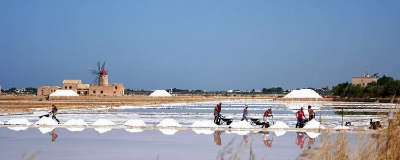 Salt workers in the Trapani Salt fields harvesting Sea Salt