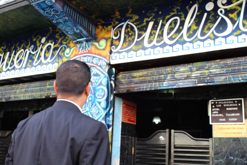 Above: Cesar entering the pulquería: where pulque, an ancient drink that is made from fermenting the juices extracted from maguey, is served.
