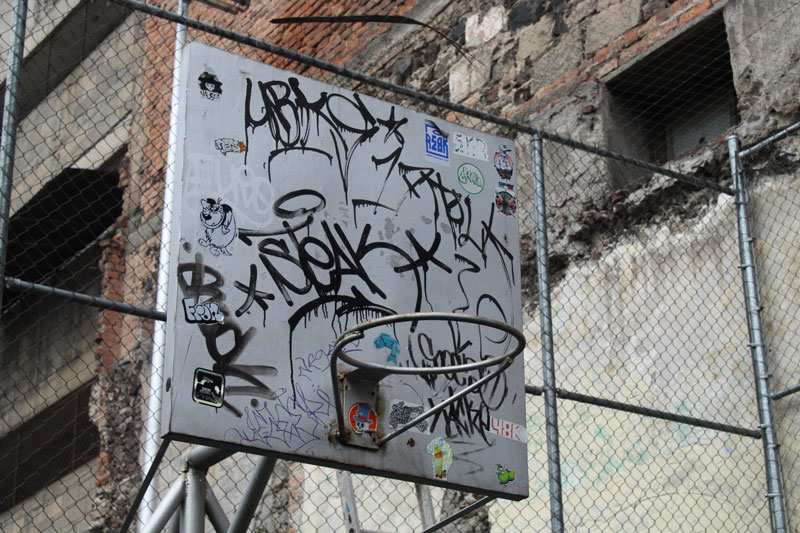 Above: The graffiti inside the soccer park seemed to be both illegal as well as legal. This basketball hoop seems to suggest a collection of tags or signatures of artists.