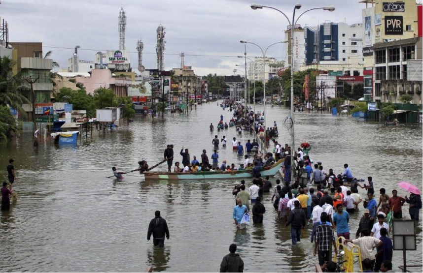 With Chennai inundated by floods, India's Finance Minister was balking at the goal of 100% clean energy.Photo via Stringer/Reuters