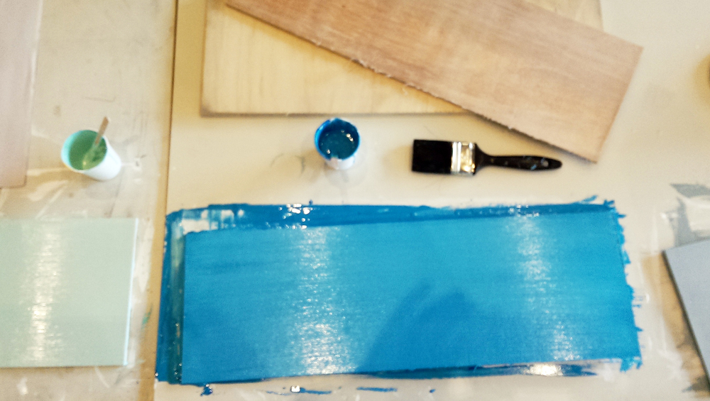 Piece of wood painted in a coat of blue
