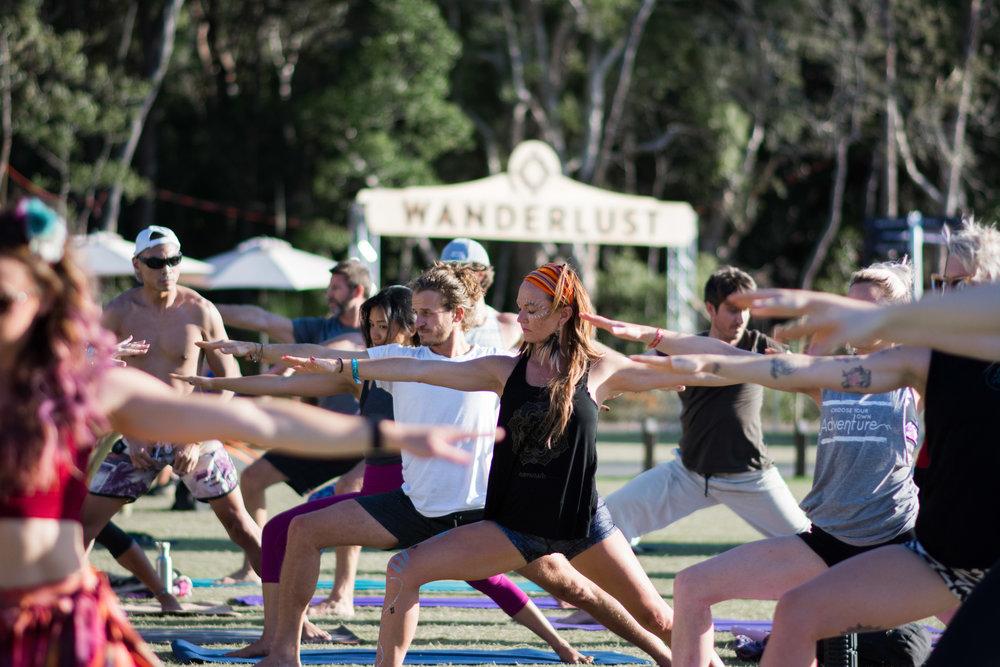 Morning yoga on the green at Wanderlust Sunshine Coast 2016