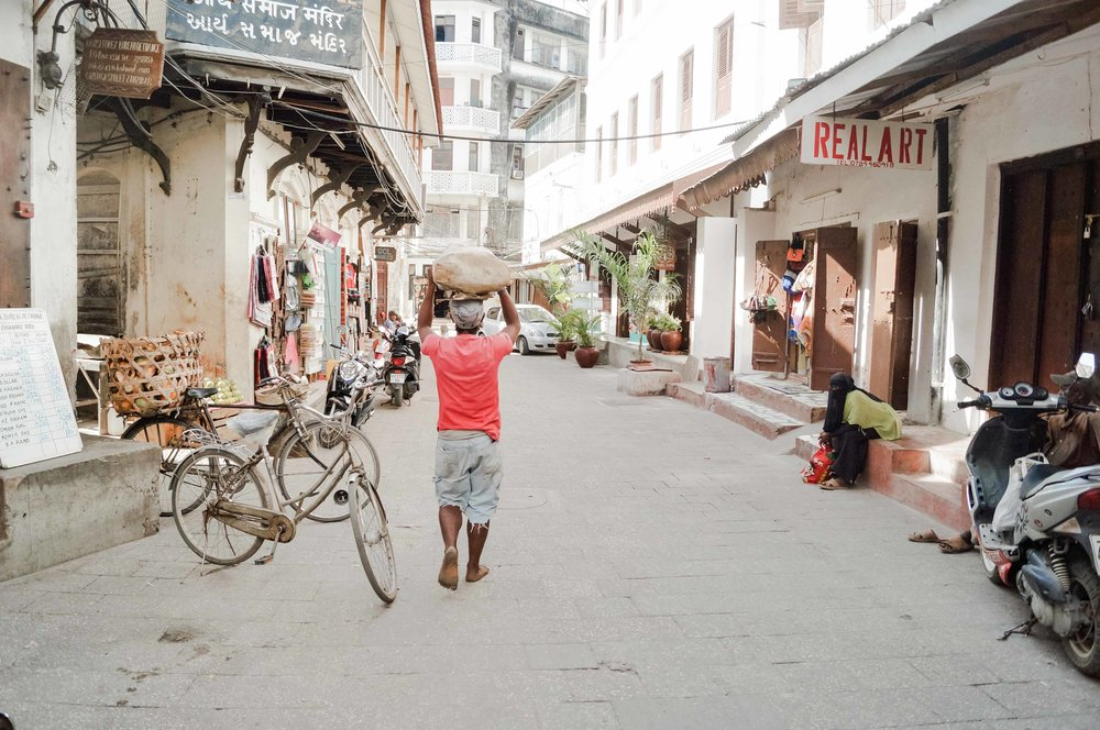 The heart of Stone Town mostly consists of a maze of narrow alleys lined by houses, shops, bazaars and mosques. Since most streets are too narrow for cars, the town is crowded with bicycles and motorbikes.