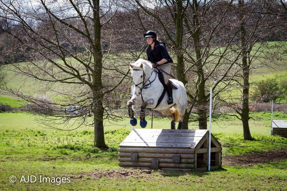 Here are Jess and Smokey - in this pic she is wearing our eQuest Grip Pro riding gloves!