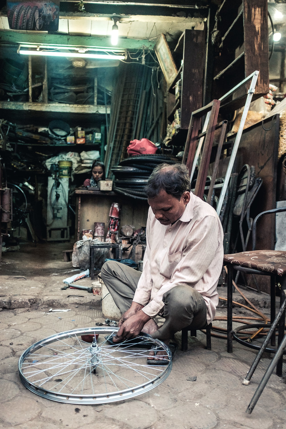 A bike fixer in New Delhi.