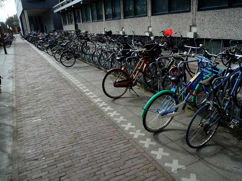 Bike-parking-amsterdam-reverse-graffiti-cleaned-advertising.JPG