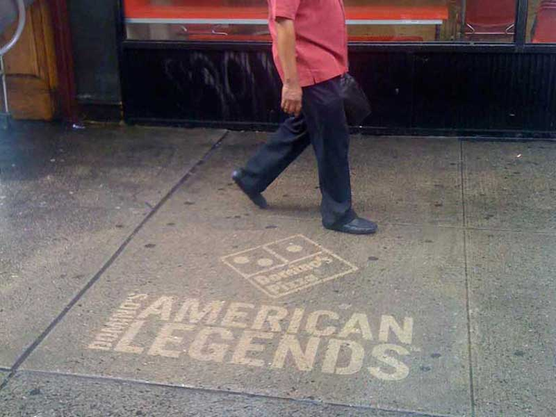 Dominos-pizza-reverse-graffiti-cleaned-advertising-sidealks-new-york-city.jpg