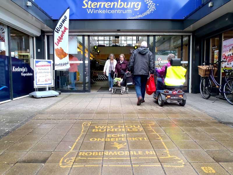 Robin-reverse-graffiti-cleaned-advertising-sidewalk.JPG