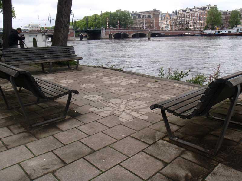 street-art-reverse-graffiti-cleaned-advertising-benches-amsterdam.jpg