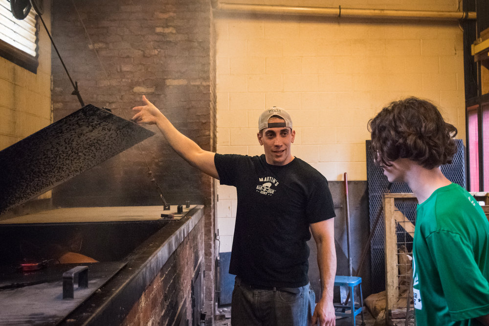 Martin's Pitmaster Jeremy Jordan shows how whole hogs are smoked at the Downtown Nashville location