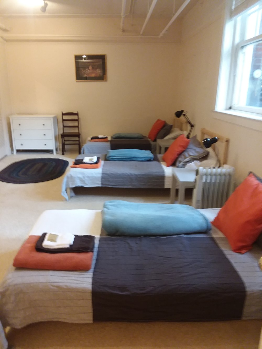 Mens Dorm - 3 beds in a row.jpg